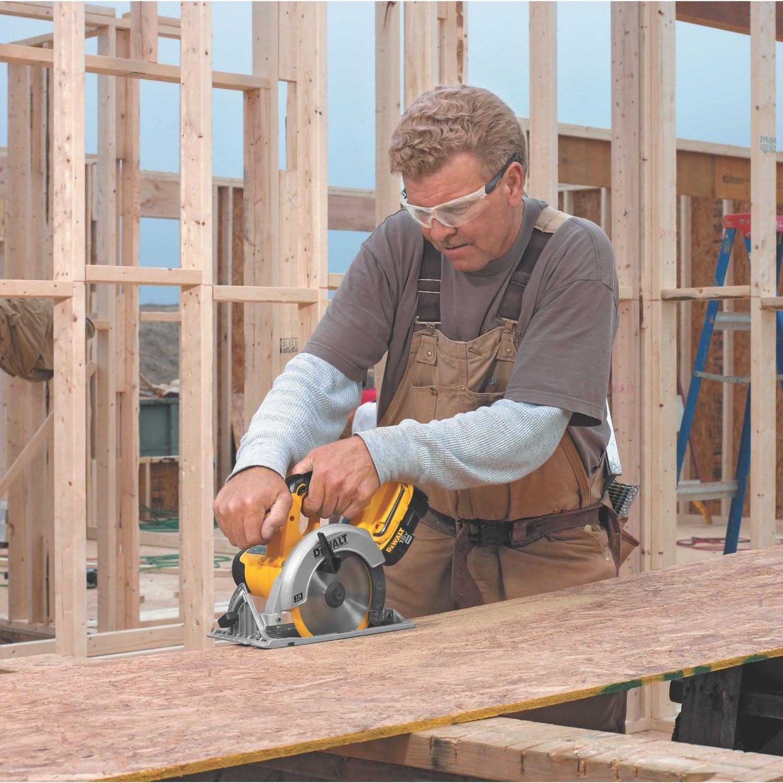 Man working with a DeWalt circular saw