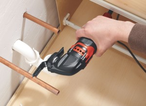 A man working with an oscillating tool